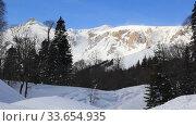Купить «Beautiful mountains covered with snow. Sunny day and blue sky on a frosty day», видеоролик № 33654935, снято 5 марта 2019 г. (c) Олег Хархан / Фотобанк Лори