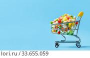 Купить «Frozen vegetables assorted on blue, top view», фото № 33655059, снято 28 апреля 2020 г. (c) Ольга Сергеева / Фотобанк Лори