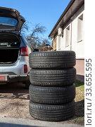 Stacking summer tyres for seasonal wheel change, spring season. Стоковое фото, фотограф Кекяляйнен Андрей / Фотобанк Лори