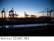 Germany, Bremerhaven - Loading cranes in the overseas port, rotors for wind turbines, back right Container Terminal Bremerhaven. Редакционное фото, агентство Caro Photoagency / Фотобанк Лори