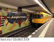 Berlin, Germany, U-Bahn line 7 enters Jungfernheide station (2019 год). Редакционное фото, агентство Caro Photoagency / Фотобанк Лори
