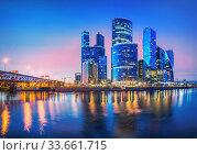 "Небоскребы ""Москва-Сити"". Moscow city skyscrapers and reflection (2017 год). Стоковое фото, фотограф Baturina Yuliya / Фотобанк Лори"