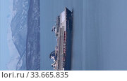 Vertical shot passenger expedition Cruise Liner Celebrity Millennium Celebrity Cruises sailing in Pacific Ocean on background of mountains coastline. Редакционное видео, видеограф А. А. Пирагис / Фотобанк Лори