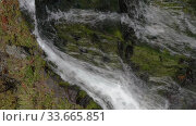 Купить «Vertical footage cascade of alpine waterfall with crystal clean and clear water flowing from snowfields and glaciers in mountains», видеоролик № 33665851, снято 24 апреля 2020 г. (c) А. А. Пирагис / Фотобанк Лори