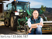 Man near tractor in vineyard. Стоковое фото, фотограф Яков Филимонов / Фотобанк Лори