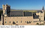 Купить «Aerial view of fortress Alcazar of Segovia. Spain», видеоролик № 33672839, снято 17 июня 2019 г. (c) Яков Филимонов / Фотобанк Лори