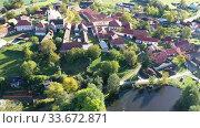 Купить «Aerial view of typical village Cakov in the Czech Republic», видеоролик № 33672871, снято 12 октября 2019 г. (c) Яков Филимонов / Фотобанк Лори