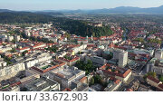Купить «Panoramic aerial view of Ljubljana cityscape with buildings and streets, Slovenia», видеоролик № 33672903, снято 3 сентября 2019 г. (c) Яков Филимонов / Фотобанк Лори