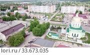 Купить «Aerial panoramic view of modern cityscape of Ozyory overlooking Orthodox Holy Trinity Church, Russia», видеоролик № 33673035, снято 13 мая 2019 г. (c) Яков Филимонов / Фотобанк Лори