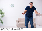 Купить «Young male contractor installing furniture at home», фото № 33673899, снято 11 ноября 2019 г. (c) Elnur / Фотобанк Лори