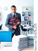 Купить «The businessman with heavy paperwork workload», фото № 33676275, снято 4 июля 2020 г. (c) easy Fotostock / Фотобанк Лори