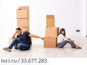 Купить «Young pair and many boxes in divorce settlement concept», фото № 33677283, снято 3 сентября 2019 г. (c) Elnur / Фотобанк Лори