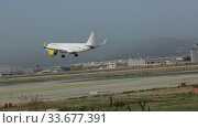 Купить «Large passenger airliner of Vueling Airlines with EC-NCS registration number landing in International El Prat Airport in Barcelona», видеоролик № 33677391, снято 24 января 2020 г. (c) Яков Филимонов / Фотобанк Лори