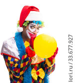 Young funny clown comedian isolated on white. Стоковое фото, фотограф Elnur / Фотобанк Лори