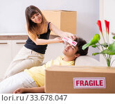 Купить «Young couple moving to new flat with fragile things», фото № 33678047, снято 5 июля 2018 г. (c) Elnur / Фотобанк Лори