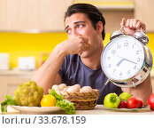 Купить «Young man in dieting and healthy eating concept», фото № 33678159, снято 19 июня 2018 г. (c) Elnur / Фотобанк Лори