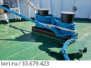 Купить «Ship is moored to the berth using a nylon rope tied to a bollard», фото № 33679423, снято 19 марта 2019 г. (c) Олег Белов / Фотобанк Лори