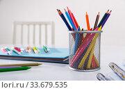 Concept of preparation for school. Different school supplies on the table. Стоковое фото, фотограф Яков Филимонов / Фотобанк Лори