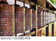 Many weels in Kodaiji temple containing the Heart Sutra. Kyoto. Japan. Редакционное фото, фотограф Serg Zastavkin / Фотобанк Лори