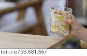 Купить «The hand of a little girl takes a glass of dessert from a wooden table. Full HD video, 240fps, 1080p.», видеоролик № 33681667, снято 14 марта 2019 г. (c) Ярослав Данильченко / Фотобанк Лори