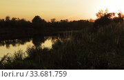 Small wild flat river at sunset. Timelapse. Стоковое видео, видеограф Aleksandr Lutcenko / Фотобанк Лори