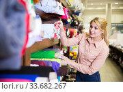 Купить «Woman choosing textiles in shop», фото № 33682267, снято 2 марта 2018 г. (c) Яков Филимонов / Фотобанк Лори