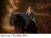 Girl with friesian horse autumn forest. Стоковое фото, фотограф Julia Shepeleva / Фотобанк Лори