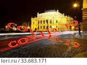 Coronavirus in Prague, Czech Republic.The building of Rudolfiunum concert halls on Jan Palach Square. Covid-19 sign. Concept of COVID pandemic and travel in Europe. (2019 год). Стоковое фото, фотограф Владимир Журавлев / Фотобанк Лори