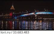 Smolensky metro bridge in Moscow shimmers with backlight. Редакционное видео, видеограф Aleksandr Lutcenko / Фотобанк Лори