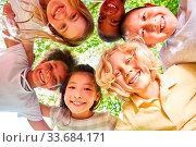 Купить «Lachende multikulturelle Kinder im Kreis als Integration Konzept», фото № 33684171, снято 26 мая 2020 г. (c) age Fotostock / Фотобанк Лори
