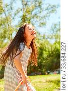Купить «Mädchen spielt ausgelassen mit dem Reifen im Park im Sommer», фото № 33684227, снято 25 мая 2020 г. (c) age Fotostock / Фотобанк Лори