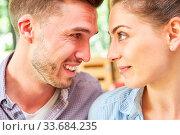 Купить «Verliebter junger Mann schaut seiner Freundin oder Frau tief in die Augen», фото № 33684235, снято 31 мая 2020 г. (c) age Fotostock / Фотобанк Лори