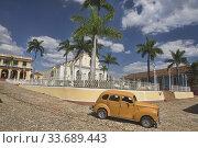 Купить «Vintage car in UNESCO World Heritage Trinidad, Cuba.», фото № 33689443, снято 18 марта 2020 г. (c) age Fotostock / Фотобанк Лори