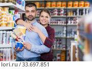 Купить «Two designer are holding paint and brushes», фото № 33697851, снято 16 февраля 2018 г. (c) Яков Филимонов / Фотобанк Лори