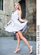 smiling woman holding dress in the hand. Стоковое фото, фотограф Яков Филимонов / Фотобанк Лори
