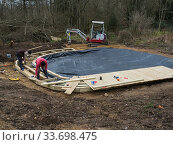 Купить «Preparatory work for construction of educational dipping pond with the liner in place, Blashford Lakes Nature Reserve. Hampshire and Isle of Wight Wildlife...», фото № 33698475, снято 29 мая 2020 г. (c) Nature Picture Library / Фотобанк Лори
