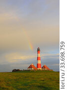 Westerhever lighthouse with rainbow, St. Peter Ording, Schleswig-Holstein Wadden Sea National Park, Germany, September. Стоковое фото, фотограф Sandra Bartocha / Nature Picture Library / Фотобанк Лори