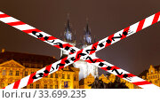 Coronavirus in Prague, Czech Republic. The gothic Church of Mother of God in front of Tyn. Quarantine sign on a blurred background. Concept of COVID pandemic and travel in Europe. (2019 год). Стоковое фото, фотограф Владимир Журавлев / Фотобанк Лори
