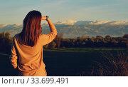 Rearview woman enjoy Sierra Nevada ridge mountains view. Spain. Стоковое фото, фотограф Alexander Tihonovs / Фотобанк Лори