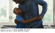 Купить «Father and son hugging each other», видеоролик № 33699527, снято 19 февраля 2020 г. (c) Wavebreak Media / Фотобанк Лори