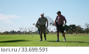 Купить «Caucasian male golfers talking on a golf course on a sunny day», видеоролик № 33699591, снято 4 ноября 2019 г. (c) Wavebreak Media / Фотобанк Лори