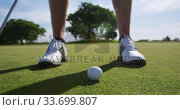 Купить «Golf player hitting the ball with his club», видеоролик № 33699807, снято 4 ноября 2019 г. (c) Wavebreak Media / Фотобанк Лори