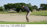Купить «Golf player hitting the ball with his club», видеоролик № 33699823, снято 4 ноября 2019 г. (c) Wavebreak Media / Фотобанк Лори