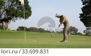 Купить «Golf player hitting the ball with his club», видеоролик № 33699831, снято 4 ноября 2019 г. (c) Wavebreak Media / Фотобанк Лори