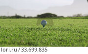 Купить «Golf player hitting the ball with his club», видеоролик № 33699835, снято 4 ноября 2019 г. (c) Wavebreak Media / Фотобанк Лори