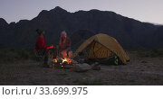 Купить «Caucasian couple camping in nature by night », видеоролик № 33699975, снято 29 ноября 2019 г. (c) Wavebreak Media / Фотобанк Лори