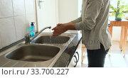 Купить «Caucasian woman washing her hands with soap at home», видеоролик № 33700227, снято 9 апреля 2020 г. (c) Wavebreak Media / Фотобанк Лори