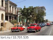 Купить «Vintage American cars used as taxis in front of the colonial buildings in Vedado district, Havana, La Habana, Cuba, West Indies, Central America», фото № 33701535, снято 17 апреля 2018 г. (c) age Fotostock / Фотобанк Лори