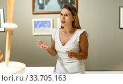 Купить «Woman observing museum exposition», фото № 33705163, снято 28 июля 2018 г. (c) Яков Филимонов / Фотобанк Лори
