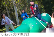 Купить «Friends having fun passing obstacle course», фото № 33710783, снято 8 июля 2020 г. (c) Яков Филимонов / Фотобанк Лори